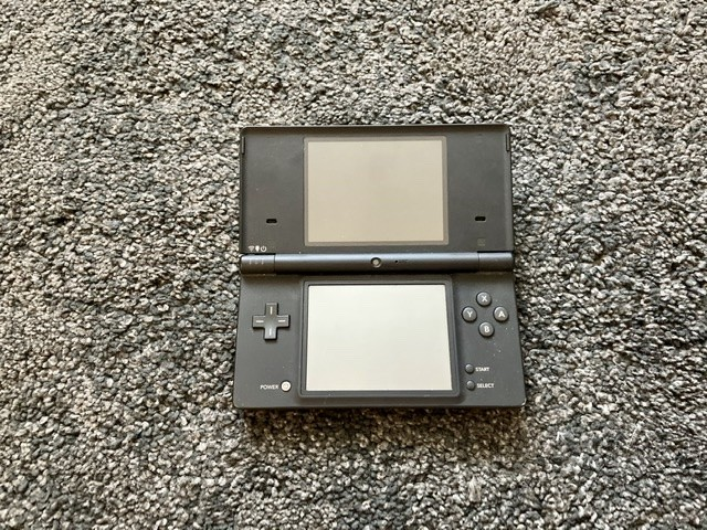 Black Nintendo DSi, case and 3 games